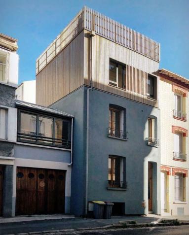 Surélevation d'une maison de ville avec ossature bois et toit terrasse - Nantes 44.
